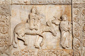 VERONA - JANUARY 27: Relief of Flight to Egypt from facade of romanesque Basilica San Zeno. Reliefs is work of the sculptor Nicholaus and his workshop on January 27, 2013 in Verona, Italy. — 图库照片