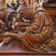 Постер, плакат: BRATISLAVA SLOVAKIA FEBRUARY 11 2014: Bear at reading symbolic carved sculpture from bench in st Matins cathedral from years 1863  1878 from manufactures of Anton Furst a Johann Hutterer