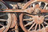 Detail of driving rod mechanism in rust on old steam locomotive — 图库照片
