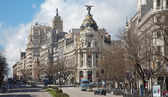 Madrid - look from Plaza de Cibeles to Cale de Alcala street and Metropolis building — Stock Photo