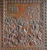 MADRID - MARCH 10: Wooden relief from indoor gate of Capilla del Obispo in March 10, 2013 in Spain. — Stock Photo