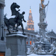 Vienna - Pallas Athena fountain and parliament in winter evening and Town hall tower in background — Stock Photo #40971291