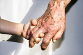 Hand of grandmother and grandchild — Stock Photo