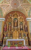 TRNAVA, SLOVAKIA - MARCH 3, 2014: Side altar of st. Joseph in Jesuits church from 19. cent. — Stock Photo