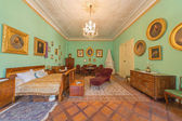 SAINT ANTON, SLOVAKIA - FEBRUARY 26, 2014: Bedroom of parents. Furniture from 19. cent in palace Saint Anton. — Stock Photo
