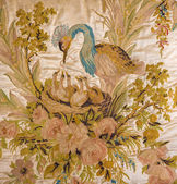 SAINT ANTON, SLOVAKIA - FEBRUARY 26, 2014: Crane bird. Detail the handmade needlework from Golden saloon from polychrome in lime wood carved furniture from 18. cent. in palace Saint Anton. — Zdjęcie stockowe