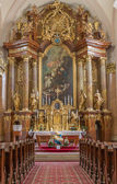 TRNAVA, SLOVAKIA - MARCH 3, 2014: Main altar (1755-1757) in Jesuits church. — Stock Photo