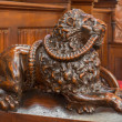 ������, ������: BRATISLAVA SLOVAKIA FEBRUARY 11 2014: Dog symbolic carved sculpture from bench in presbytery in st Matins cathedral from years 1863 1878 from manufactures of Anton Furst a Johann Hutterer