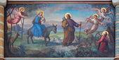 VIENNA, AUSTRIA - FEBRUARY 17, 2014: Flight of holy family to Egypt fresco by Josef Kastner from 1906 - 1911 in Carmelites church in Dobling. — Stock Photo
