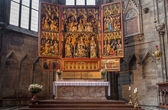 VIENNA, AUSTRIA - FEBRUARY 17, 2014: The Wiener Neustadter gothic wings altar from year 1447 in the side nave of St. Stephens cathedral or Stephansdom. — Stock Photo