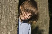 Sorrow of little girl in the wood — Stock Photo