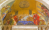 VENICE, ITALY - MARCH 11, 2014: Exterior mosaic from st. Mark cathedral over the side portal. Death of Saint Mark the Evangelist. — Stock Photo