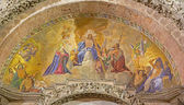 VENICE, ITALY - MARCH 11, 2014: Exterior mosaic from st. Mark cathedral over the main portal. Jesus the King in the heaven and hl. Mary and st. John the Baptist. — Stock Photo