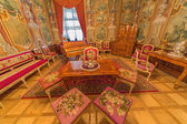 SAINT ANTON, SLOVAKIA - FEBRUARY 27, 2014: Rome saloon from 18. cent. in palace Saint Anton with the handmade needlework on the chairs and textile wallpapers with the busts of Caesars. — Stock Photo