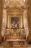 BOLOGNA, ITALY - MARCH 16, 2014: Main altar of Chiesa di San Gregorio e San Siro  with the  Miracolo del Corporale (eucharist miracle) di San Gregorio by Denijs Calvaert. — Stock Photo