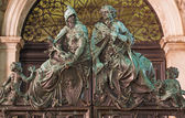 Venice - Bronze statue from gate of bell tower. — Stock Photo