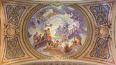 BOLOGNA, ITALY - MARCH 17, 2014: Ceiling restored fresco in baroque church Saint Mary Magdalene or Santa Maria Maddalena with the motive of assumption of the saint. — Stock Photo