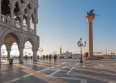 VENICE, ITALY - MARCH 12, 2014: Doge palace and Saint Mark square and San Giorgio Maggiore church in background in morning light. — Stok fotoğraf