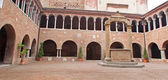 BOLOGNA, ITALY - MARCH 16, 2014: Atrium in st. Stephen or Santo Stefano churches complex. — Стоковое фото