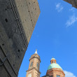 Bologna - Torre Asinelli and Torre Garisenda towers and church of st. Bartolomeo e Gaetano. — Stock Photo #44244177