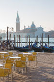 Venice - Chairs on Saint Mark square and San Giorgio Maggiore church in background in morning light. — Stock Photo