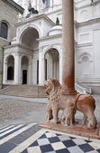 BERGAMO, ITALY - JANUARY 29: Lion and the column of portal from Basilica Santa Maria Maggiore and the entry of Dom on January 29, 2013 in Bergamo, Italy. — Stock Photo