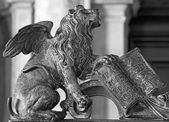 Venice - Lion bronze statue as symbol of st. Mark the Evangelist - patron of the town from gate of bell tower. — Stock Photo
