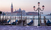 Venice - Waterfront of Saint Mark square and San Giorgio Maggiore church in background in morning light. — Stock Photo