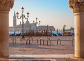 Venice - Waterfront of Saint Mark square and column of Doge palace and San Giorgio Maggiore church in background in morning light. — Stok fotoğraf