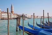 VENICE, ITALY - MARCH 13, 2014: Canal grande and boats for church Santa Maria della Salute. — Stock Photo