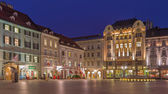 BRATISLAVA, SLOVAKIA - JANUARY 23, 2014: Main square in evening dusk with more architectonic styles. — Stock Photo