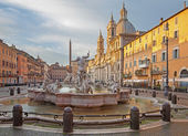 Rome - Piazza Navona in morning and Fountain of Neptune (1574) created by Giacomo della Porta and Santa Agnese in Agone church — Stock Photo
