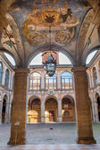 BOLOGNA, ITALY - MARCH 15, 2014: Ceiling and atrium from the entry to external atrium of Archiginnasio. — Foto de Stock