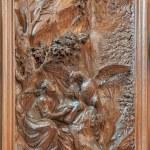 MECHELEN, BELGIUM - JUNE 14, 2014: Carved relief the Writing of the Gospel of Saint John the Evangelist by Ferdinand Wijnants in st. Johns church or Janskerk from begin of 20. cent. — Stock Photo #48968467