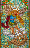 ROZNAVA, SLOVAKIA - APRIL 19, 2014: Archangel Michael from windowpane from 19. cent. in the cathedral. — Stock Photo