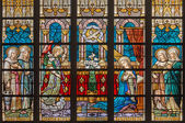 BRUGES, BELGIUM - JUNE 12, 2014: The Annunciation on windowpane in St. Salvator's Cathedral (Salvatorskerk) by stained glass artist Samuel Coucke (1833 - 1899) — Stock Photo