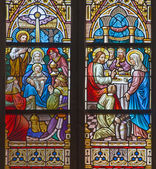 BRUGGE, BELGIUM - JUNE 12, 2014: The Adoration of Magi and the Wedding at Cana scene on the windwopane in st. Jacobs church (Jakobskerk). — Stock Photo