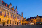 BRUGGE, BELGIUM - JUNE 12, 2014: The Burg square and facade of gothic town hall. — Stock Photo