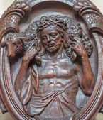 BRUGES, BELGIUM - JUNE 13, 2014: The carved relief of Jesus in the bond on the confession box in Karmelietenkerk (Carmelites church) by carmelite Victor van de Heilige Jacob fromk 17. cent. — Stock Photo