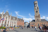 BRUGGE, BELGIUM - JUNE 13, 2014: Grote markt with the Belfort van Brugge and Provinciaal Hof building. — Stock Photo