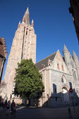 BRUGES, BELGIUM - JUNE 13, 2014: Church of Our Lady from south - west in evening light — Stock Photo