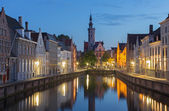 Brugge - Canal and Spigelrei and Spinolarei street with the Burghers lodge building at dusk. — Stock Photo