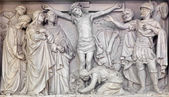 MECHELEN, BELGIUM - JUNE 14, 2014: Stone relief the Crucifixion of Jesus in church Our Lady across de Dyle. — Zdjęcie stockowe