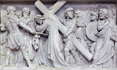 MECHELEN, BELGIUM - JUNE 14, 2014: Stone relief Simon of Cyrene help Jesus to carry his cross  in church Our Lady across de Dyle. — 图库照片