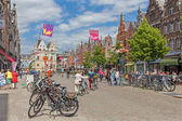 MECHELEN, BELGIUM - JUNE 14, 2014:  IJzerenleen street or square with the gothic building of Groot Begijnhof (Large Beguinage) in the background. — Stock Photo