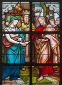 MECHELEN, BELGIUM - JUNE 14, 2014: The Espousals of Virgin Mary and st. Joseph scene from the windowpane in st. Johns church or Janskerk from begin of 20. cent. — Stock Photo