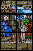 MECHELEN, BELGIUM - JUNE 14, 2014: The holy family on windowpane in st. Katharine church or Katharinakerk. — Stock Photo