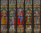 MECHELEN, BELGIUM - JUNE 14, 2014: The heart of Jesus and the saints on windowpane in st. Katharine church or Katharinakerk. — Stock Photo