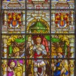 BRUSSELS, BELGIUM - JUNE 16, 2014: Stained glass window depicting the Archangel Gabriel in the center (1843) in the cathedral of st. Michael and st. Gudula. — Stock Photo #48973801