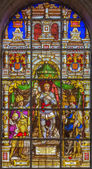 BRUSSELS, BELGIUM - JUNE 16, 2014: Stained glass window depicting the Archangel Gabriel in the center (1843) in the cathedral of st. Michael and st. Gudula. — Stock Photo
